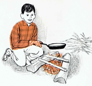 boy-cooks-over-fire